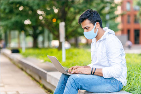 College student wears mask on campus