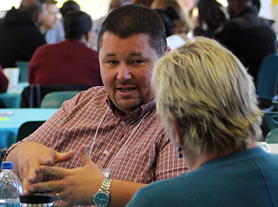 Clinton Slaughter of Butte College shares with colleagues during the networking breakfast.