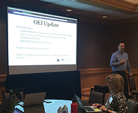 Jory Hadsell, Executive Director of the California Community Colleges Online Education Initiative (OEI), presents at an OEI Consortium meeting in November.