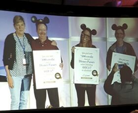 Pat James with winners of $100 off of Disneyland tickets for next year's Online Teaching Conference